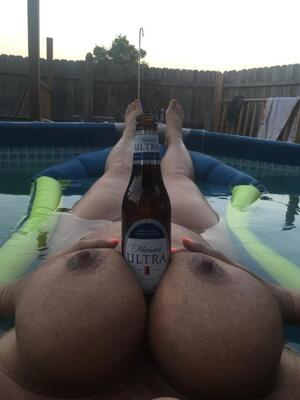 Boobs and beer in the pool