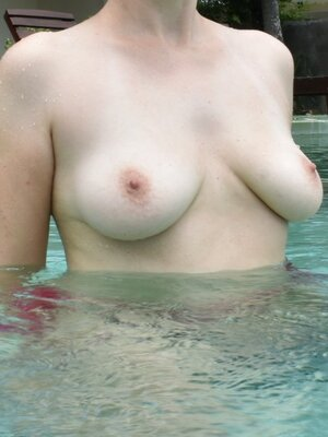 Bare tits in the pool