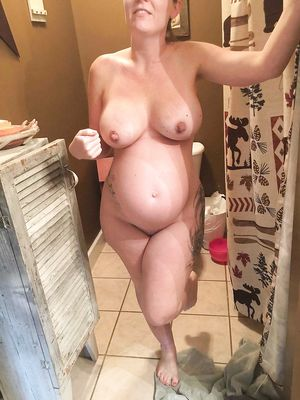 Pregnant MILF in Shower