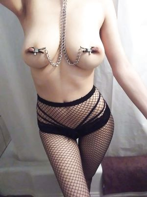 Girl in Fichnet With Chain on Nipples