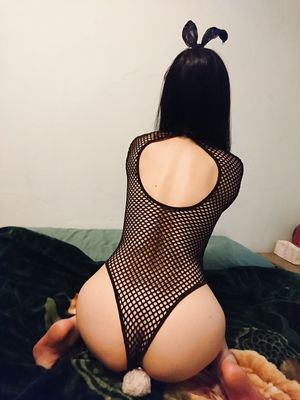 Bunny obediently posing in her fishnet leotard